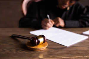 A judge signing documents