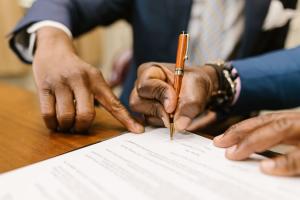man signing a divorce agreement